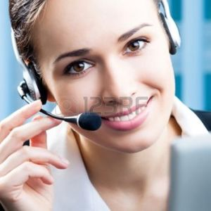 13319349-portrait-of-happy-smiling-cheerful-support-phone-operator-in-headset-at-office
